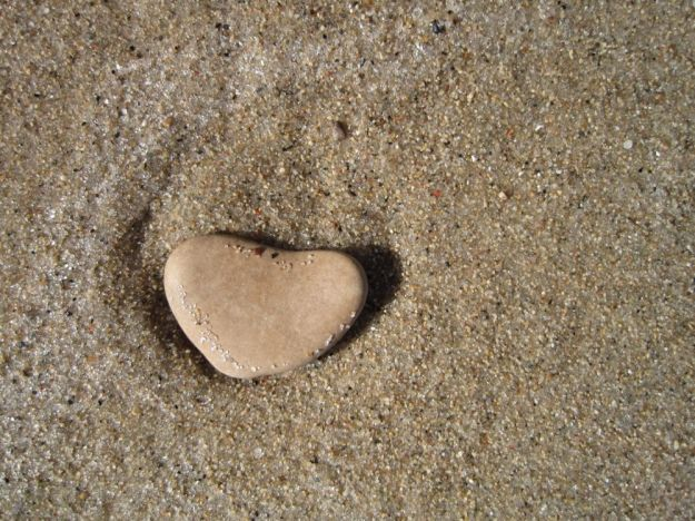 stone heart on beach